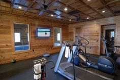 Rustic home gym. With family pool seen through the windows! Workout Room Home, Workout Rooms, Exercise Rooms, Bike Room, Gym Room, Pallet Ceiling, Family Pool, Home Gym Equipment, Through The Window