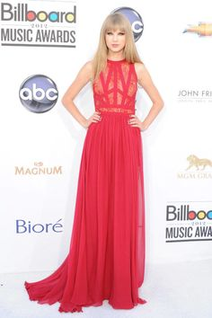 In Elie Saab at the 2012 Billboard Music Awards. See Taylor Swift's full fashion evolution, from sequins in 2007 to her many crop tops today.