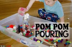 Set up a pom pom pouring station for a fun, easy activity that toddlers will love. Let toddlers scoop, transfer, and dump pom poms in fun sensory play.