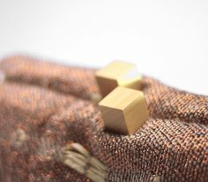 Woody // details. Ladies clutch in handwoven fabric. 80% linen, 20% poly, wood closure. Charlotte Bronze.