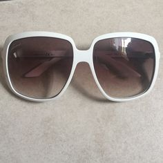 Authentic White Gucci Sunglasses Authentic White Gucci Sunglasses. Gucci logo on right lens. GG logos on temples have faded from normal wear. ❌ No trades ❌ Gucci Accessories Sunglasses