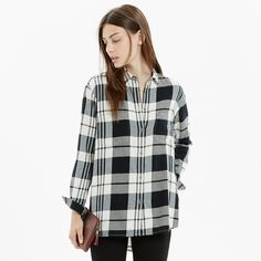 Give your button down + sweater combo an added dose of warmth with a flannel layer. | 25 Happy Clothing Ideas Guaranteed To Get You Through The Winter