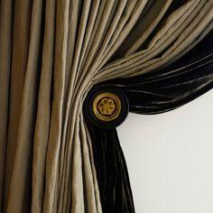J O H N . M I N S H A W . silk and velvet curtains with stunning doorknob holdback.