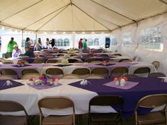 White tablecloth with an eggplant overlay and lavender napkins