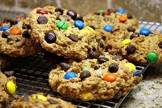 Monster Cookies are basically a peanut butter- oatmeal cookie with chocolate chips and M candies mixed in.  I dot extra M's and chocolate chips on top of each blob of cookie dough on the baking sheet.  This ensures that they will be extra pretty when they are all baked up and ready to eat.