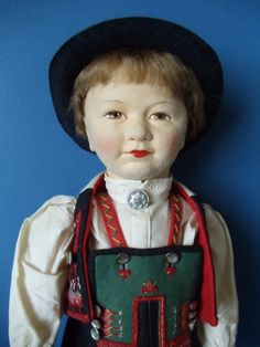 Ronnaug Petterssen, who created splendid Norwegian costume dolls in the 1930s to 1950s. He is all original, dressed in a colorfully embroidered felt regional costume of Setesdal, Norway. He has a pressed felt head with beautifully hand-painted features, a light brown mohair wig, and a stuffed cloth body. | eBay!