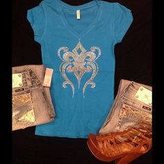 Beautiful Blue Tee~ Size M Fleur De Lis Design~beautiful Vneck Tee ~ Pair this with the pair of miss me jeans ~ this one has just the right amount of bling to make you sing! Ayankoya Custom Tops Tees - Short Sleeve