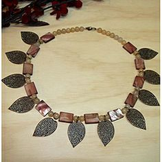 """Susen Foster Designs """"Change of Season"""" - This necklace combines beautiful mother of pearl and agate stones in a lovely and eye-catching design with lacy brass leaves."""