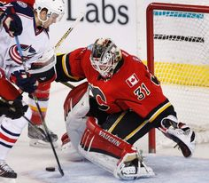 Calgary Flames goalie Karri Ramo, right, from Finland, makes a save against Columbus Blue Jackets' Alexander Wennberg, from Sweden, during the first period of an NHL hockey game, Friday, Feb. 5, 2016 in Calgary, Alberta. (Larry MacDougal/The Canadian Press via AP)