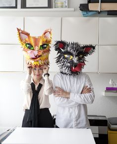 A portrait of Elisabeth and Peter wearing masks.