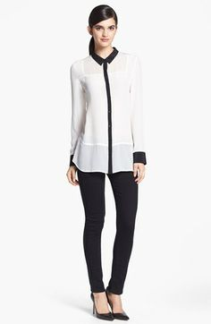 """Sheer insets at the yoke and a bold horizontal seam across the hips lend distinctive style to a lightweight silk blouse.  29"""" length (size Medium). White Snow is sheer"""