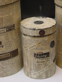 Recycle oatmeal boxes~ cover with book pages. Or instead of destroying old books, use wallpaper samples or old magazines. Victorian trading company comes to mind
