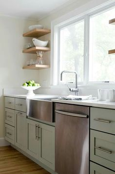 Beautiful Kitchen Features Sage Green Cabinets Paired With
