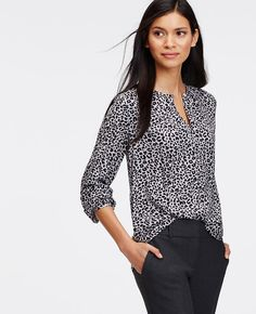 An alluring keyhole defines this gorgeously draped blouse, confidently cast in the season's most wanted hues. Wear it buttoned or unbuttoned - and easily take the look from day to evening. Shirred jewel neck with keyhole and button closure. Long sleeves with shirred cuffs and button closure. Shirttail hem.