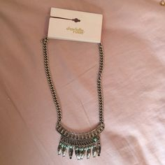 Sliver necklace with blue jewels Silver and baby blue statement jewelry that has never been worn. I would wear it with spring and summer clothes and pastels! Dressy casual! Charlotte Russe Jewelry Necklaces