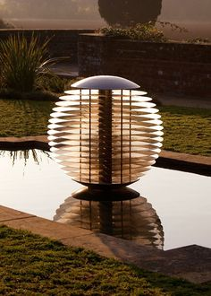 Ether Garden Globe - a globe water feature sculpture in stainless steel
