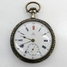 Omega Gold Plate Pocket Watch on LiveAuctioneers Pocket Watch Antique, Old Watches, China Porcelain, Omega, Pendant Watch, Plate, Antiques, Clocks, Gold