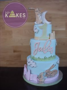 Guess How Much I Love You cake. Cakes iced in buttercream. Bunnies, bows and decorations are marshmallow fondant.