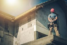 Supervising House Construction by duallogic. Construction Site Supervisor Taking Look on the Building Fr. Residential Roofing, Residential Construction, New Construction, New Housing Developments, Roof Installation, Roofing Services, Roof Styles, Roof Repair, Flat Roof