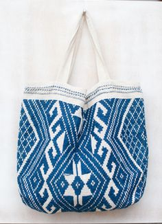 This hand woven tote bag is created from organic cotton and natural dyes by a village of women in Laos.