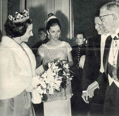 Fabiola, in the strawberry leaf tiara, with her sister-in-law, Paola, along with the King of Sweden