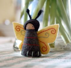 embroidered wool felt and wood butterfly fairy.  by Stephanie Schleicher