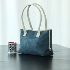 Faux leather handbag padded and structured fits ipad and other necessities.