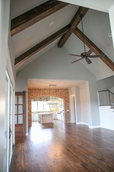 Oh but that brick accent and those beams are giving me ALL the    Farmhouse Grey Paint Color: Sherwin Williams SW7016 Mindful Grey.
