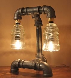 Industrial Style Pipe Lamp with Clear Glass my Cody could make this in a heartbeat. What a fun idea.