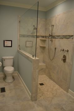 Beautiful new tiles and brushed nickel hardware make for a true master bath oasis.