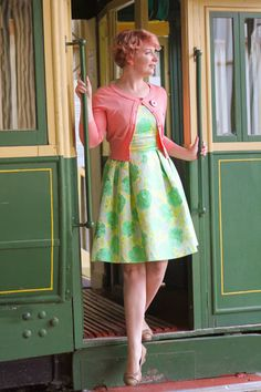 Love this mint-colored dress with the peach cardi. #StyleGallery