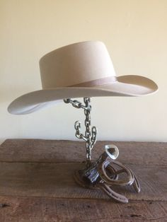 Resting cowboy horseshoe hat rack with chain cactus. I like the way the log turned out.
