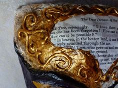 June 1st: Here I used the gold paint over the entire surface, rather than just sticking to the raised details.  I then applied a wash of darker colour acrylic to try and define the cracks and imperfections  -  by QueenHare for the Design Every Day Project