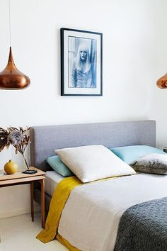 A Taste of Summer: Beautiful Australian Beach House -- Love this retro color palette of bright mustard yellow, shining copper, slate gray, turquoise and white, in this sleek and minimalist midcentury modern bedroom. Style At Home, Home Bedroom, Bedroom Decor, Bedroom Ideas, Bedroom Lighting, Bedroom Inspiration, Bedroom Chandeliers, Bedroom Apartment, Bedroom Lamps