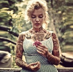 Painted lady: Marilyn Monroe looks like a rockabilly with her chest and arms covered in tattoos