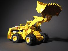 https://flic.kr/p/RHQoxX | Marathon LeTourneau L-1200 LeTro-Loader | Diesel-electric wheel loader  The prototype featured a 22-cubic-yard bucket and was suited to load 150 to 170 ton haul trucks like the Euclid R-170.  My model in scale 1:28.5 has all the functions of the original:  - All-wheel drive with planetary gear reduction in each wheel hub using two PF XL motors - Articulated steering by means of two linear actuators powered by a PF M motor - Pneumatic lift arm with four-cylinder…