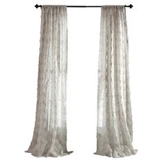 Add textural appeal to your master suite or guest room with this luxe textured curtain, featuring a ribboned accent and shimmering sequins. ...