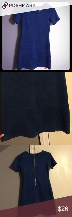 Gorgeous Fitted Blue suede dress Blue suede dress with sexy gold zipper down the back. Comfortable, form fitting and sharp this dress is a favorite of mine. Lightly worn great condition. Wish I still fit into it. Price is firm lovemarks Dresses Mini