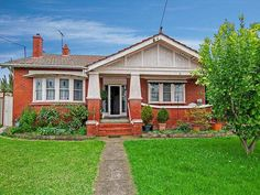 Photo of a brick californian bungalow house exterior with porch & window awnings - House Facade photo 1363501. Browse hundreds of images of californian bungalow house exteriors & photos of brick in facade designs.