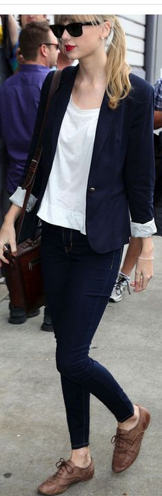 Who made  Taylor Swift's black sunglasses, brown lace up shoes, and blue blazer that she wore on November 27, 2012?