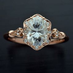 Oval Engagement ring with a 8X6 Moissanite Forever One in 14kt