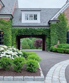 porte cochere covered in Boston Ivy brick walls of home House Landscape, Landscape Design, Boston Ivy, Ivy Wall, Forest Cottage, Wall Exterior, Old Mansions, Wall Trim, Custom Home Builders