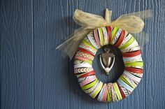 Dress up your door with this holiday wreath! Why buy a wreath when you can make one at home? This bright and colorful DIY project lets you design a piece that suits your style. Easy enough for the whole family to craft together, this Mason jar lids and washi tape wreath can be altered throughout the year to adapt to any holiday.