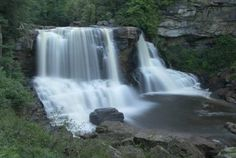 One of West Virginia's most famous waterfalls is just a few minutes away from downtown. Blackwater Falls State Park is home to its namesake waterfall, a cascade of water that sometimes appears dark, thanks to its high content of tannic acid. Davis Wv, Places Around The World, Around The Worlds, Places Ive Been, Places To Go, Blackwater Falls, Famous Waterfalls, Black Water, Weekend Getaways