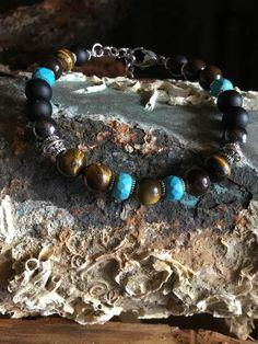 Bracciale artigianale onice,occhio di tigre,turchesi ,ematite ,elegante raffinato e per tutte le occasioni .Realizzato da Nath Sicilia. Nath stone jewelry