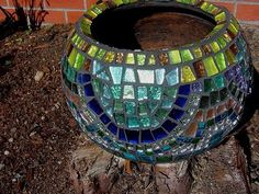Mosaic pieces are a great way to recycle broken glass and dishes.  This is stunning in the garden!!