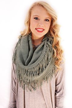 Wild and Free Infinity in Seafoam - Knit plus fringe tassels make this plush sea foam infinity scarf a bold and unique piece. It's cozy with a bohemian flair, and definitely trendy.  - available online at http://www.envyboutique.us/shop/wild-free-infinity-seafoam/ #Envy #Boutique #chic #fashion #fashiontrends #InfinityScarf, #KnitScarf, #SeaFoamScarf