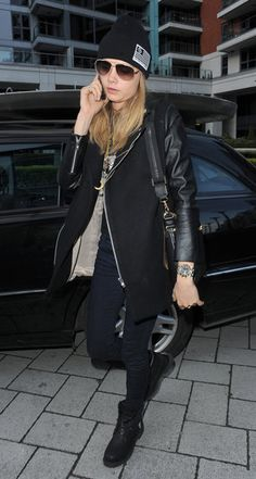 Cara Delevingne was tough in London in all black: a leather-sleeved jacket, skinny denim, a ribbed beanie, and combat boots.