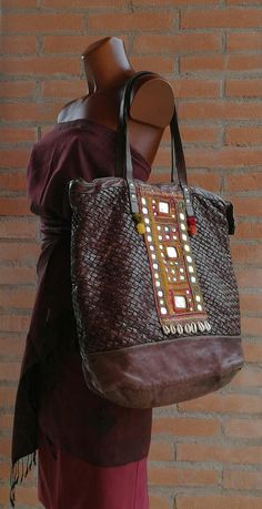 e6264cef966d7 Wonderful woven leather bag, embellished with an antique Banjara textile.  #wovenleather #campomaggi