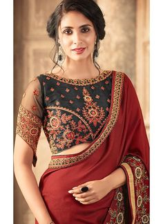 Burgundy and Black Embroidered Georgette Saree features a beautiful georgette saree. Embroidery work is completed with zari, thread, and stone.